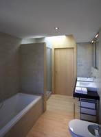 Simple bathroom with partitioned shower area