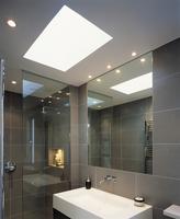 Modern, grey-tiles bathroom with skylight above designer sin 20052012278| 写真素材・ストックフォト・画像・イラスト素材|アマナイメージズ