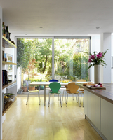 Colourful, Bauhaus shell chairs at dining table in front of