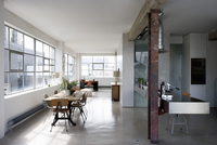 Vintage-style dining area and designer kitchen in loft apart