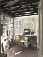 Narrow room with desk in bay window