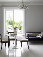 Living room with round table & chairs, sofa & chandelier