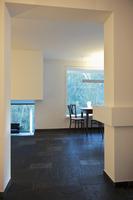 Open-plan living-dining room with Norwegian slate floor