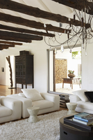 Ethnic style in spacious house - simple, modern sofa set and