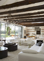 Large, open living room with curved metal wirechandeliers ha