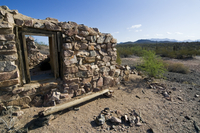 Ruin of the long abandoned gold and silver Victoria mine, Organ Pipe Cactus National Monument, Arizona, US. (Photo by: Arterra/U