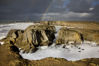Rainbow during storm at sea, Cote Sauvage, Quiberon, Brittany, France. (Photo by: Arterra/UIG)