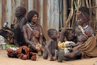 Women with children and babies of the Hamar Tribe sitting on the ground, Dimeka, South Omo / Debub Omo, Ethiopia, East Africa. (
