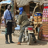 Policeman and motorbike rider in the city Agadez, Niger, Western Africa. (Photo by: Arterra/UIG)