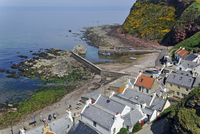The smal Pennan harbor, a small coastal village in Aberdeenshire, Scotland, UK. (Photo by: Arterra/UIG)