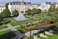 Replica of Egyptian wooden boat and statue of Auguste Mariette in city park at Boulogne-sur-Mer, France. (Photo by: Arterra/UIG)