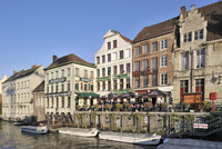 Pavement cafes along the river Lys at Ghent, Belgium. (Photo by: Arterra/UIG)