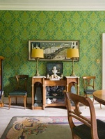 Dining room of 18th century Sussex home papered with vibrant