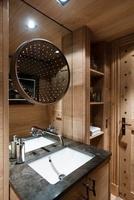 Swiss Chalet with interior designed by Tino Zervudachi, Gsta