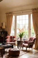 Pair of matching armchairs upholstered in Kathryn Ireland fa