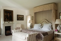 Farmhouse bedroom with fabric detailling