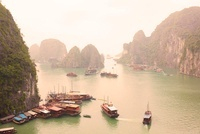 A Number Of Junk Boats Docked Near Halong Bay, Vietnam.
