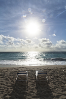 Two Chairs In The Sun On The Beach