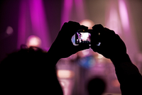 Fan Taking A Picture At A Rock Concert.