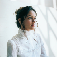 Portrait Of Woman In White Blouse.