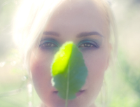 Portrait Of Woman'S Face Behind A Leaf