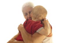 Grandmother Hugging Toddler