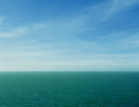 The Horizon Of Green Sea And Blue Skies