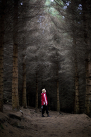 Woman Standing In Clearing In Woods