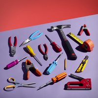 An Assortment Of Tools Laying Out On A Purple Surface.