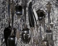 Silverware On A Foil Background.