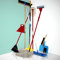 Mops, Brooms And Dustpans In The Corner Of A Blue And White