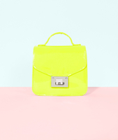 Bright Neon Yellow Women'S Handbag On A Pastel Background.