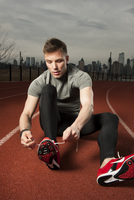 Runner Lacing Shoes On Track.