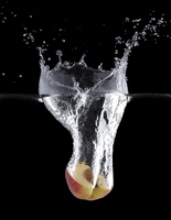 Peach Half Making Splash In Water