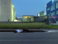 Man Sleeping On Side Of Road
