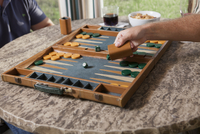Two Men Play A Game Of Backgammon On A Summer Day.