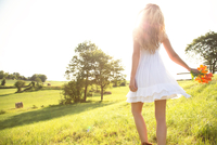 woman looking out on idyllic meadow