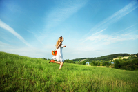 woman skipping in field