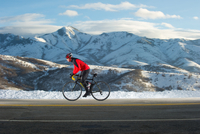 man road biking in winter, Mountain Dell, Wasatch Mountains,
