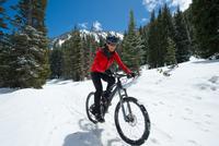 woman mountain biking on Bypass Road, Little Cottonwood Cany