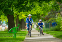 mother and son riding their bikes in park, Salt Lake City, U