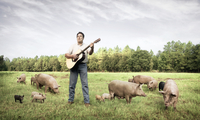 A rancher starts off his day singing to his pigs