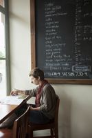 young adult female reading in caf_