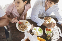 Man and woman laughing over dinner