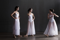 Three ballerinas discussing the choreography and dances