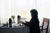 Senior woman enjoys room service