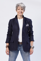 Caucasian Woman 50-60 Years Old In Jeans And Striped Blazer,