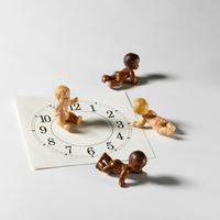 Four Baby Dolls On Clockface