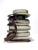 Stack Of Film Reels With Some Film Unrolled 1