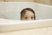 Young Girl In A Bathtub Peeking Out